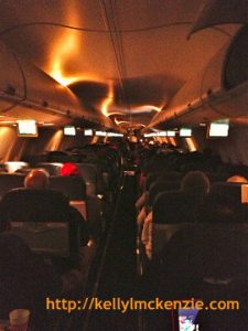 Cozy nightime interior shot aboard aircraft http://kellylmckenzie.com/