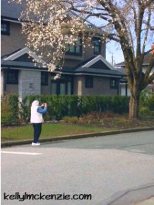 Mom photographing Cherry Blossoms in April http://kellylmckenzie.com/still-blossoming-at-91/